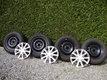 Quatre pneus Hiver sur jantes tolées